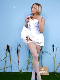 Gorgeous blonde in sexy stockings loses her clothes to a..