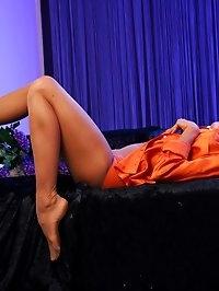 Leggy redhead sex-bomb in hot shining pantyhose