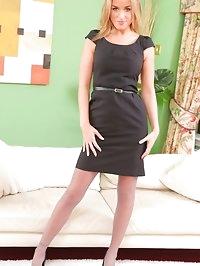 stunning blonde in short black dress