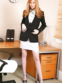 Lovely Monika wearing a black jacket and miniskirt in her..