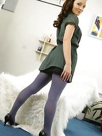 Stunning brunette in sheer green minidress, black skirt..