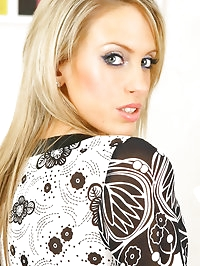 Blonde Ellie wearing a minidress with black stockings &..