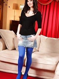 Georgina D in a tiny denim miniskirt and tight black top..