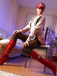 Sexy leggy babe in black stockings and red boots