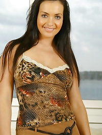 Dark haired beauty Courtney on a long brown skirt,..