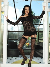 Leggy MILF Julie D takes off her thigh highs and teases us