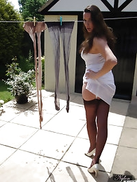 Nylon Jane hanging out her laundry and wearing lingerie