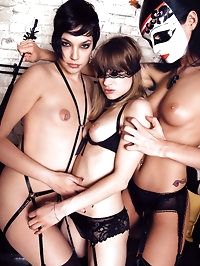 Three fetish masked women in sexy lingerie