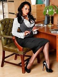 Secretary Danica masturbates at her desk with her dildo