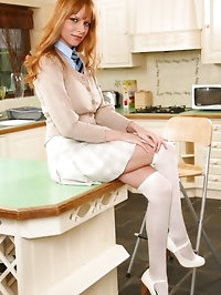 Stunning redhead Monika seductively removes miniskirt and..
