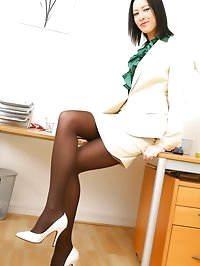 Brunette Carole looks delightful in her cream suit and..
