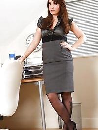 Wonderful brunette in knee length skirt and black..