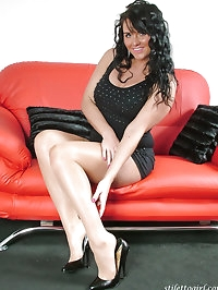 Black high heels make this dark haired babe look fantastic