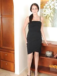Elegant brunette Hailey Murphy slips out of her black..