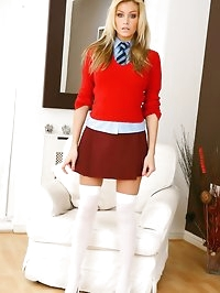 Natasha in red college miniskirt and white over knee socks.